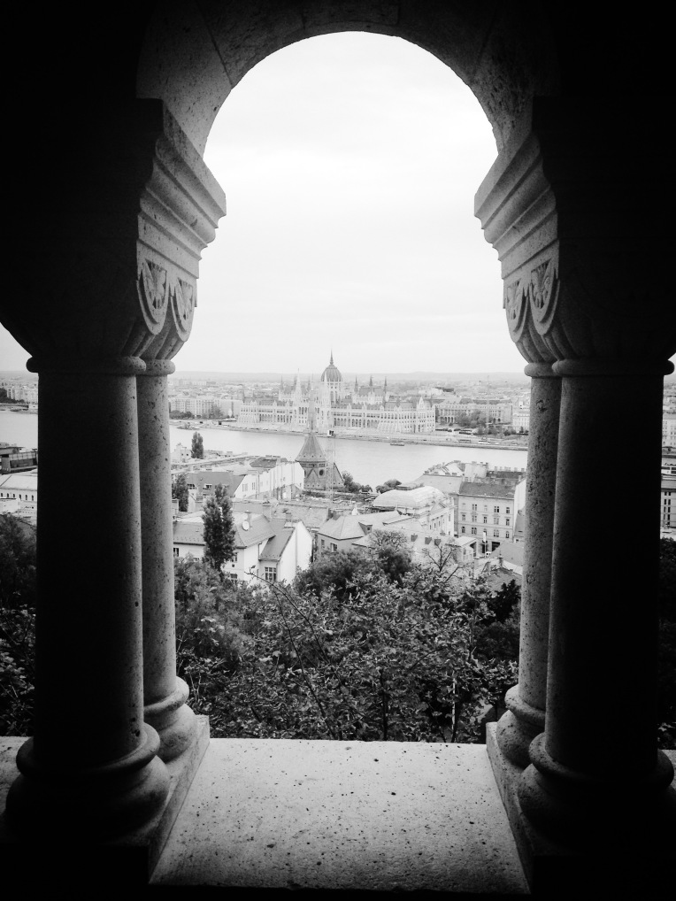Photograph. 'Fisherman's Bastion, Budapest, Hungary.'  View of the Hungarian Parliament Building from the Fisherman's Bastion, on the Buda side of the Danube. Buda is the ancient capital of Hungary, and one of three territories that make up the modern city of Budapest. In 1686 Buda was reconquered from the Ottoman Empire.@davidasutton @sketchbookexplorer Facebook.com/davidanthonysutton #b&w #photography #budapest #hungary #travel #travelblog #buda #fishermansbastion
