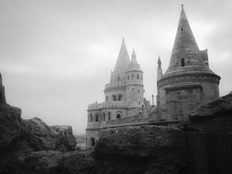 Photograph 2. 'Fisherman's Bastion, Budapest, Hungary.'  This neo-gothic and neo-romanesque modern castle was almost destroyed in World War Two. The bastion has seven tours, symbolising the seven Hungarian tribes who settled the Carpathian basin in the 800s. It stands on Buda Hill overlooking Budapest. @davidasutton @sketchbookexplorer Facebook.com/davidanthonysutton #b&w #photography #budapest #hungary #travel #travelblog #buda #fishermansbastion