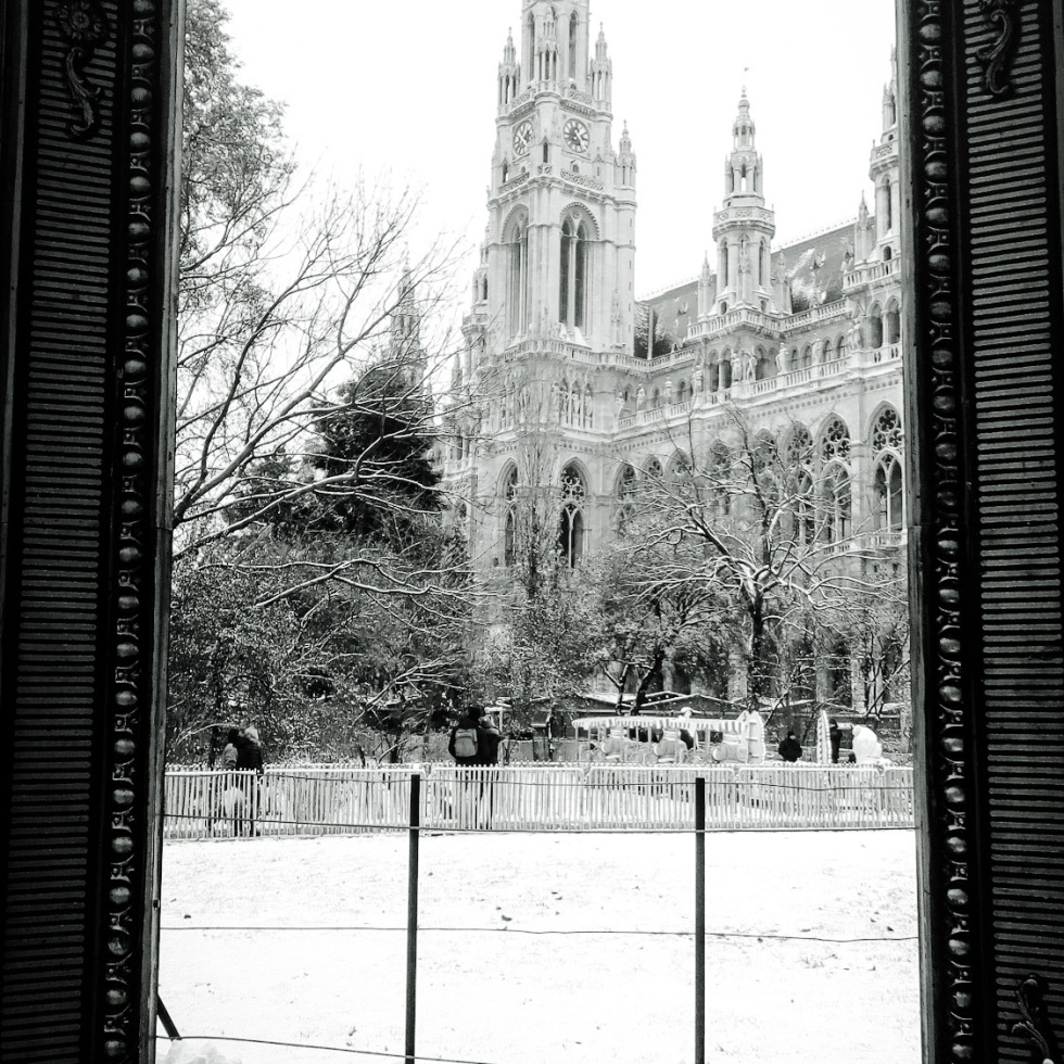 Urban photo - Vienna, Austria. 'Viennese Dream Christmas Market, 2.' This giant pictureframe was set up for selfies, but I thought Vienna's City Hall deserved a selfie of its own. sketchbookexplorer.com @davidasutton @sketchbookexplorer Facebook.com/davidanthonysutton #photograph #b&w #vienna #travel #travelblog #viennachristmas